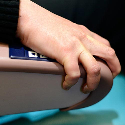image of clenched hand on airplane armrest