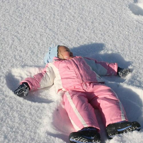image of child making a snow angel