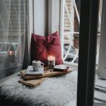 image of window seat with tea and book